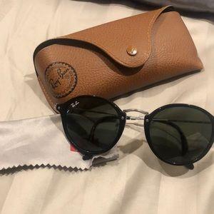 51 mm round black on black ray ban sunglasses.